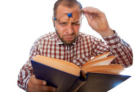 eyesight: Horizontal photo of geek with poor eyesight reading a book on white background Stock Photo