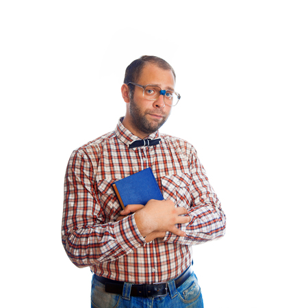 classbook: Sad geek guy with book looking at camera on white background