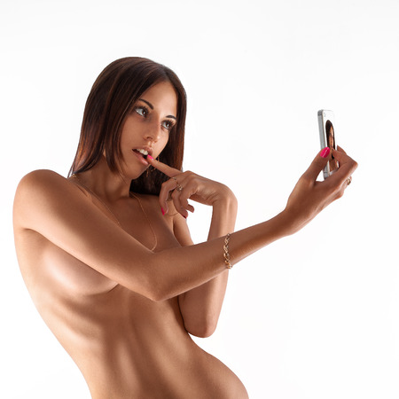 nude breasts: Isolated on white background woman making erotic selfie. studio shot. square. Stock Photo