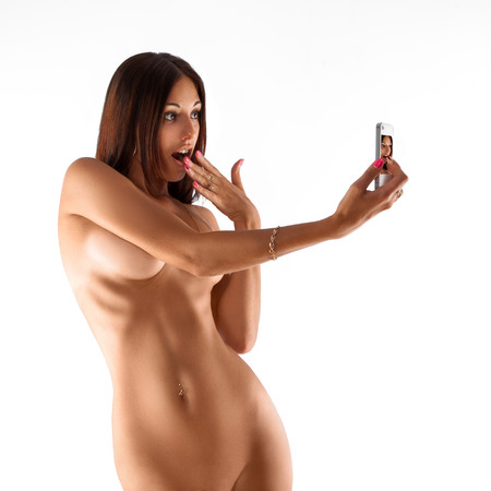 nude breasts: Slim adult woman in studio making seduction  selfie. white background. isolated. square.