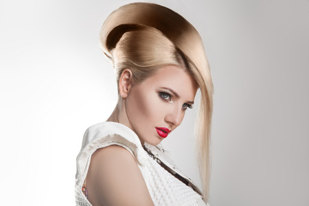 horizontal haircut: Haircut. Beautiful Girl with Healthy Short Blond Hair. Hairstyle. Studio shot. Horizontal