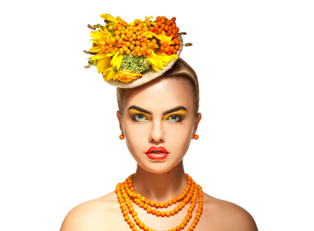 rowanberry: Serious fashion model with rowan bouquet on head and rowanberry on neck, White background Stock Photo
