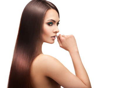 Beauty lady with makeup and perfect straight hair on white background Stock Photo