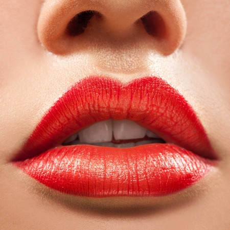 lipstick kiss: Macro photo of woman lips with red lipstick Stock Photo