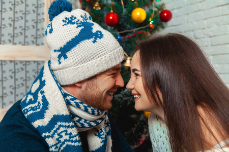 lovely women: Couple in love near Christmas tree. New year. Christmas mood.