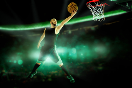 basketball court: Horizontal portrait of professional basketball player makes slam dunk in the game. Basketball game. NBA. Sportsman plays basketball.