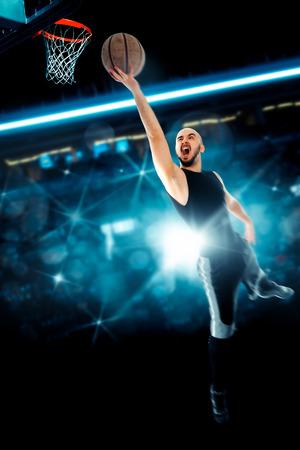 Man playing basketball and makes slam dunk on game. . Basketball game. Sportsman plays basketball.