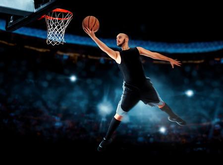 layup: Photo of basketball player makes layup in the game.  . Basketball game. Sportsman plays basketball.