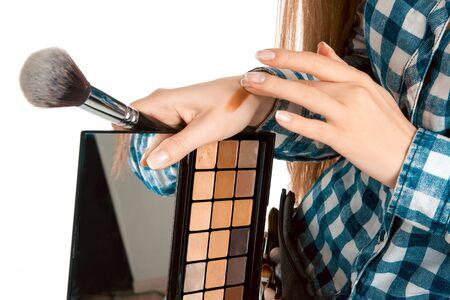 make up artist: Girl testing foundation on hand isolated on white background. Creative makeup artist. Make up artist.