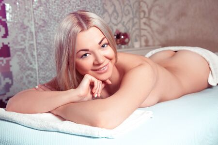 beauty resort: Beauty young blonde girl relaxing in spa salon. Beautiful blonde relaxing in spa. health, beauty, resort and relaxation concept