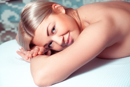 beauty resort: Healthy and young blonde woman in spa salon. Beautiful blonde relaxing in spa. health, beauty, resort and relaxation concept