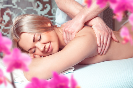 beauty resort: portrait of young beautiful woman in spa environment. health, beauty, resort and relaxation concept. Beautiful blonde relaxing in spa.