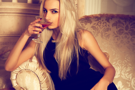 voluptuous: Sexual blonde woman drink martini.