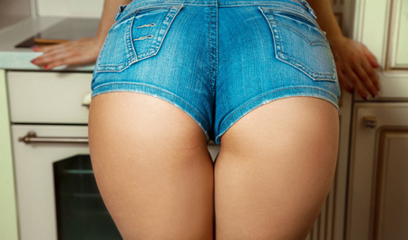 female ass: Sexual female ass in jeans shorts.