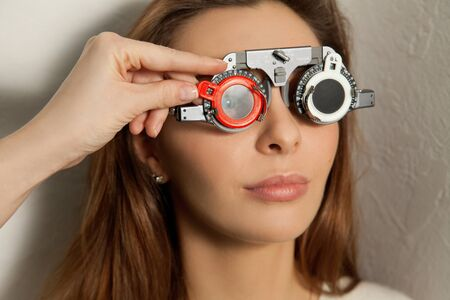 fundus: pretty woman checks vision in an ophthalmologist with corrective lenses.