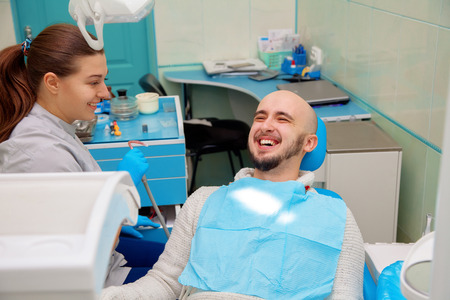 Dentist having fun with patient during treatment.