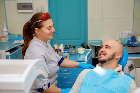 odontolith: Happy dentist and patient in the dental office.