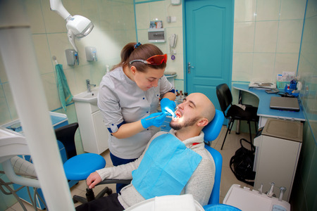 odontolith: Healthy teeth patient at dentist office dental caries prevention. Stock Photo