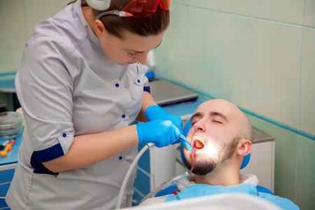 examined: Man having teeth examined at dentists.