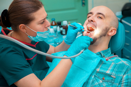 odontolith: Nice man makes prevention of caries on dental checkups.