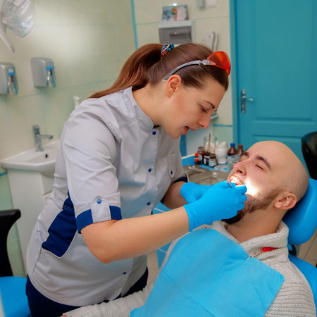 odontolith: patient on the examination of the teeth at the dentist. Stock Photo