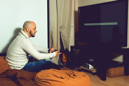 Elegant male playing computer games on tv. concept of leisure entertainment and fun