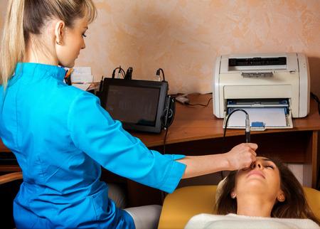 fundus: Charming woman checks eyesight ophthalmologist. Ophthalmologist. medical, health, ophthalmology concept