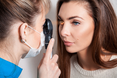 astigmatism: Ophthalmologist examines the eyes using a ophthalmic device. Ophthalmologist. medical, health, ophthalmology concept