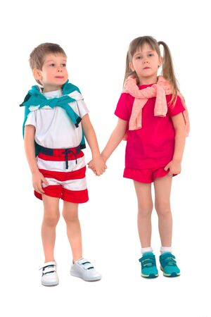 frendship: Little boy and girl holding hands on a white background