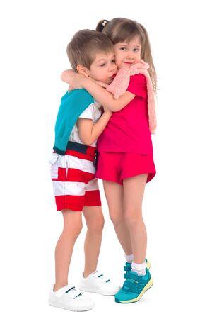 frendship: Little girl hugging boy on a white background Stock Photo