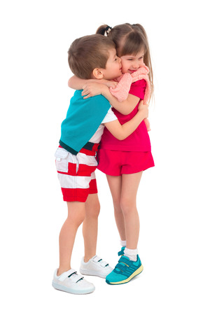 frendship: A little boy hugs and kisses the little girl on the cheek