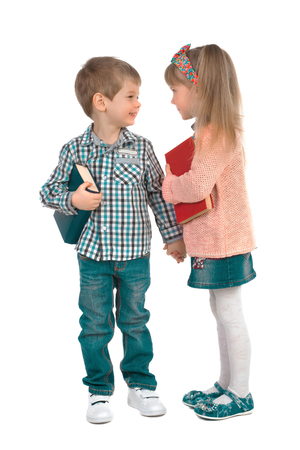 checkered skirt: Girl and boy with books holding hands on a white background