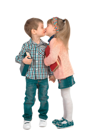 Girl and boy with books holding hands and kissing on a white background
