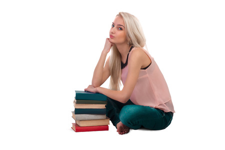 shoeless: Beautiful girl posing with books Stock Photo