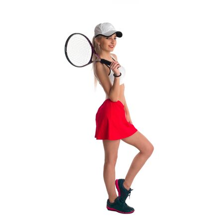 tennis skirt: Beautiful girl in a cap and a red skirt with a tennis racket on a white background