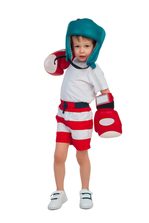 boxing boy: Small boy in boxing gloves and a helmet shows the rack isolated on white background