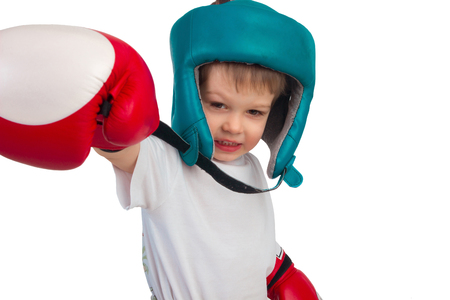 boy boxing: Boy in boxing gloves and helmet posing on a white background