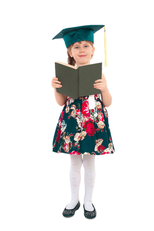 Prodigy: Little girl with a book and wearing a hat on a white background