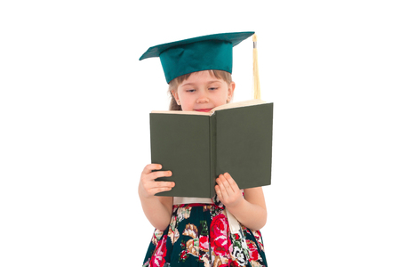 prodigy: Little girl in the hat is reading a book and smiling