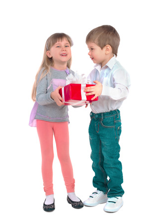 children clothing: Little boy and girl are holding a gift box
