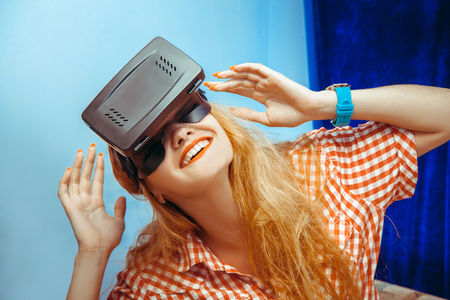 close up portrait of Cheerful beauty girl in virtual reality helmet. VR glasses. Virtual reality. Third dimension. Stock Photo