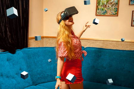 dimension: beauty cheerful young girl in virtual reality helmet. VR glasses. Virtual reality. Third dimension.