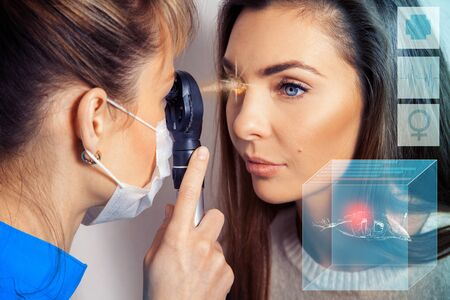 future medicine: Ophthalmologist examines the eyes using a future ophthalmic device with laser sensor. Ophthalmologist. Virtual sensors for vision checking. Future medicine and health concept.