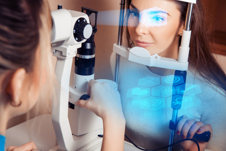 future medicine: patient during an eye examination at the eye future clinic. Ophthalmologist. Virtual sensors for vision checking. Future medicine and health concept.