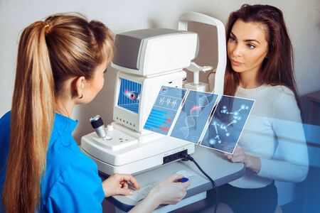 consulted: woman consulted an ophthalmologist about her vision at the future clinic. Ophthalmologist. virtual sensors for vision testing. Future medicine cooncept.