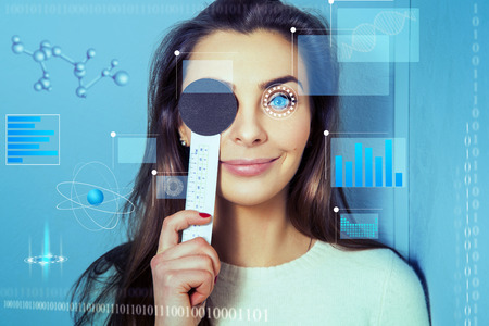 testing vision: young beautiful woman checks the vision clinic in the future ophthalmologist. Virtual sensors for vision testing. Ophthalmologist. future medicine concept