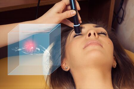 future medicine: Pretty young brunette girl checks her vision at the ophthalmologist. Future medicine concept art with device for virtual testing of eye disease