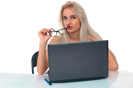 Girl works at a laptop on a white background Stock Photo