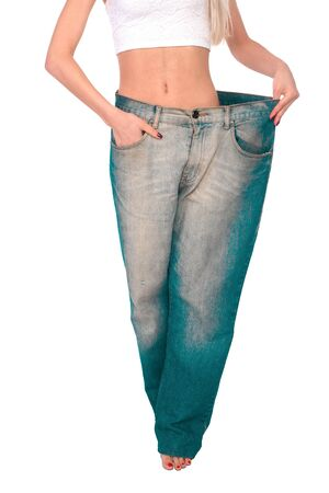 shoeless: Girl blonde tries on jeans a very large size