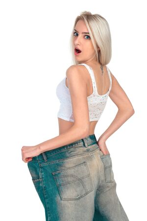 wonderment: Girl blonde tries on jeans a very large size